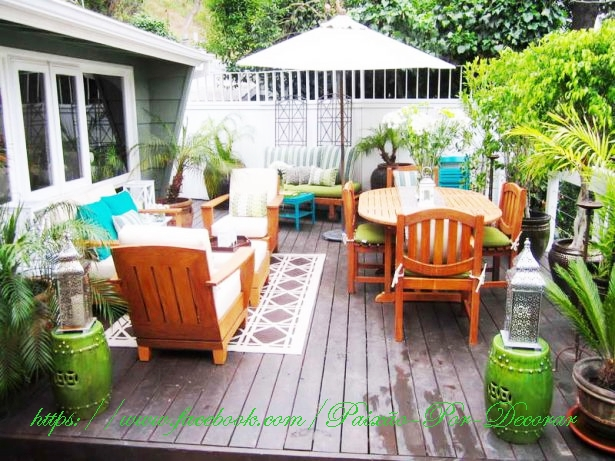 contemporary-small-garden-design-with-oval-teak-wood-table-sets-under-umbrella-also-using-cushion-615x461